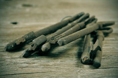Old and rusty keys. Some old and rusty keys on a rustic wooden table Royalty Free Stock Photo