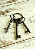 Old rusty keys on wooden boards Stock Photo
