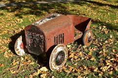 Old rusty kid`s pedal car Stock Photo