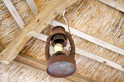 Old rusty lamp  bower straw ceiling electric bulb Royalty Free Stock Photo