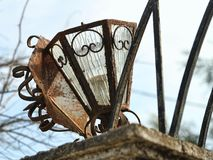 An old rusty lamp. In a deserted garden Royalty Free Stock Photo