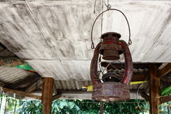 Old Rusty Lamp Hang On Dusty Ceiling Royalty Free Stock Photography
