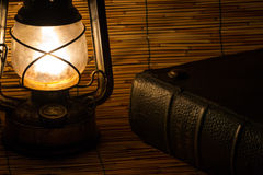 Old rusty lantern and a book Royalty Free Stock Images