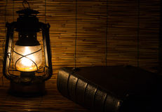 Old rusty lantern and a book Stock Photos