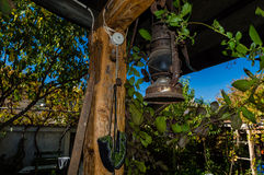 An old rusty lantern. Vintage outdoor garden and an old rusty lantern Stock Photography