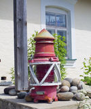 Old and rusty latern standing before museum Stock Photos