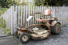 Old rusty lawn mower Stock Images