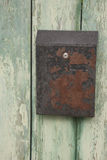 Old rusty letterbox. On a fence Stock Image