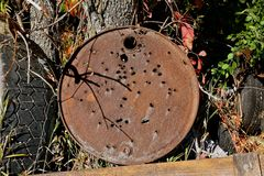 Old barrel lid used as a shooting target Stock Photography