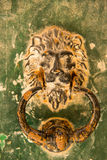 Old rusty lion head knocker. In the medieval city of Mdina, Malta Stock Images