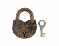 An old rusty lock and key. An old rusty key lock securely locking the door Stock Images