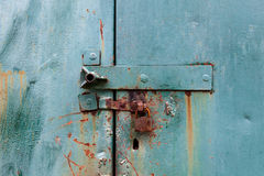 Old  rusty lock on the metal blue gate Royalty Free Stock Photos