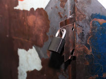 Old and rusty lock on a metal door Royalty Free Stock Images