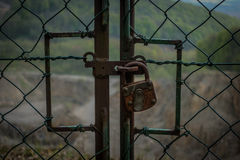 The old and rusty lock on a metal gate Royalty Free Stock Image