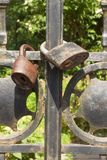 Old rusty lock on a metal gate into the garden. Lock on the iron gate. Symbol imprisonment and slavery. Property security chain Stock Image