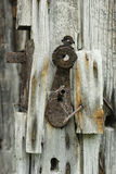 Old rusty lock in a mountain wooden cabin Stock Photo