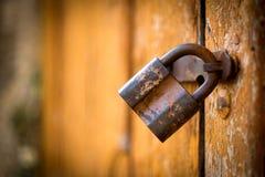 Free Old Rusty Lock On The Vintage Wooden Door Stock Photo - 58954540