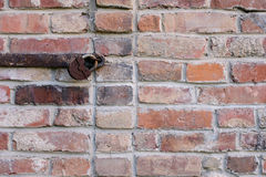 Old rusty lock on the wall of red brick Royalty Free Stock Images