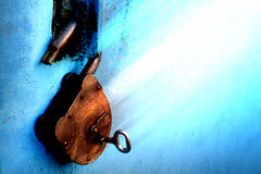 Free Old Rusty Lock With A Key On A Blue Background Royalty Free Stock Photo - 90237025