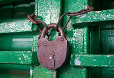 Old rusty lock on a wooden door Stock Photos