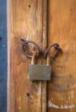 Old rusty lock on wooden door Stock Photos