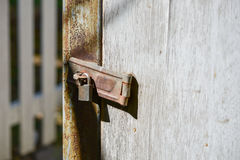 Old rusty lock on the wooden gate Royalty Free Stock Image
