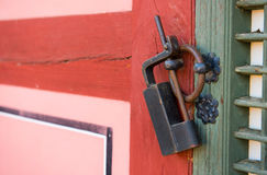 Old rusty lock on the wooden gate. Royalty Free Stock Photos