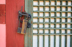 Old rusty lock on the wooden gate. Stock Photography