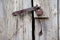Old rusty lock on a wooden shed Stock Photos