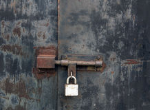 Old rusty locked metal gate. Royalty Free Stock Image