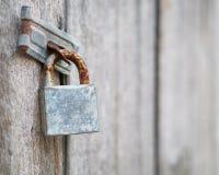 Old rusty locks. On wooden door Stock Image