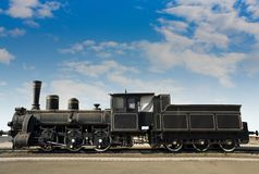 Old rusty locomotive. With the blue sky background royalty free stock photo