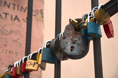 Old and rusty love locks on iron lattice Stock Photos