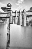 Old rusty love padlocks on a bridge. Black and white picture of old rusty padlocks on a bridge, love symbol, shallow depth of field Royalty Free Stock Photography