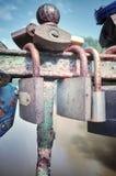 Old rusty love padlocks on a bridge. Retro stylized picture of old rusty padlocks on a bridge, love symbol, shallow depth of field Royalty Free Stock Image