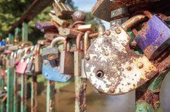 Old rusty love padlocks on a bridge. Royalty Free Stock Photo