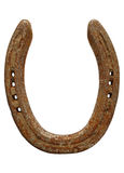Old rusty lucky horseshoe isolated over white. Royalty Free Stock Image