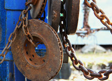 Old, rusty machines on fresh air. Inside, loads, chains, weights rust from old age. Equipment for outdoor fitness, history. Vintage look Royalty Free Stock Image