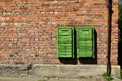 Old rusty mail boxes on brick wall. Old rusty mail boxes on the brick wall. Green vintage mailboxes. Ukraine stock image
