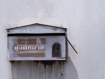 Old rusty mailbox on the wall ,Mailbox is Thai Language Stock Image