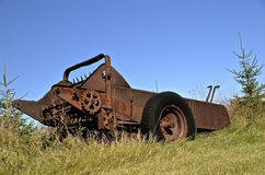 Old rusty manure spreader in the long grass Stock Images