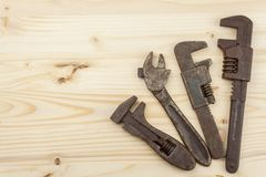 Old rusty mechanics tools on a wooden background. Advertising for new tools. Sales tools Royalty Free Stock Photography