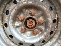 Old rusty metal alloy wheel car Royalty Free Stock Image
