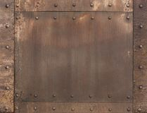 Old rusty metal background with rivets Royalty Free Stock Image