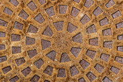 Old rusty metal drain cover. Brown texture Stock Photos
