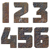 Old rusty metal english alphabet, numbers and signs. Isolated Stock Photos