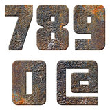 Old rusty metal english alphabet, numbers and signs. Isolated Royalty Free Stock Photo