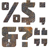 Old rusty metal english alphabet, numbers and signs. Isolated Royalty Free Stock Images