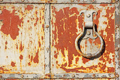 Old rusty metal gate with handle ring. Stock Photography