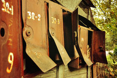 Old rusty metal mailboxes, vintage filter processing Royalty Free Stock Images